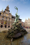 Antwerp. BELGIUM - OCTOBER 26: The statue of the Throwing of the Giant Hand in front of City Hall on October 26, 2013 in  in , Belgium. City Hall sits in the Stock Photo