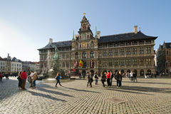 Antwerp. BELGIUM - OCTOBER 26: The statue of the Throwing of the Giant Hand in front of City Hall on October 26, 2013 in  in , Belgium. City Hall sits in the Royalty Free Stock Image