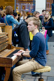 Antwerp. BELGIUM - OCTOBER 26: An unidentified young busker plays the piano on the street on October 26, 2013 in  in , Belgium Royalty Free Stock Photography