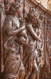 Antwerp - Carved statue of angel with the mug in St. Charles Borromeo church Royalty Free Stock Photo