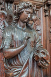 Antwerp - Carved statue of angel with the skull in St. Pauls church (Paulskerk) Stock Images