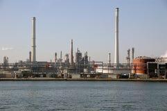 Antwerp harbour industries. Scenic view of industrial buildings on shoreline of Antwerp harbor, Belgium Royalty Free Stock Image