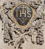 Antwerp - Jesuits baroque heraldry from west portal of baroque church of Saint Charles Boromeo. On September 4, 2013 in Antwerp, Belgium Stock Photography