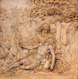 Antwerp - marmorlättnad av den barmhärtiga barnsamaritplatsen i kyrka för St. Charles Borromeo Fotografering för Bildbyråer