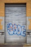 Grafitti on a metal shutter door in Antwerp city center, Belgium. ANTWERP-MAY 21, 2018. Graffiti on metal shutter in city center. According its street art policy stock photography