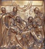 Antwerp - Metal relief of Pieta  from Joriskerk or st. George church as part of cross way cycle Royalty Free Stock Photo