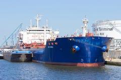 Antwerp oil tanker. ANTWERP, BELGIUM - JULY 9: Oil tanker moored near an oil silo in Port of Antwerp July 9,2013 in Antwerp, Belgium. The Port of Antwerp is the Stock Image