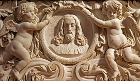 Antwerp - Relief of Jesus head and angels in St. Pauls church  (Paulskerk) Royalty Free Stock Photos