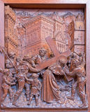 Antwerp - Simon of Cyrene helps Jesus to carry his cross.. Carved relief in St. Pauls church (Paulskerk) Stock Photography