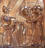 Antwerp - Simon or Simon of Cyrene helps Jesus to carry the cross. Metal relief from Joriskerk or st. George church Stock Images