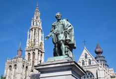 Antwerp - Statue of painter P. P. Rubens and tower of cathedral Stock Photo