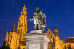 Antwerp - Statue of painter P. P. Rubens and tower of cathedral Stock Photography