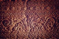 Antyczna ściana z rytownictwami - rocznika skutek fotografia stock