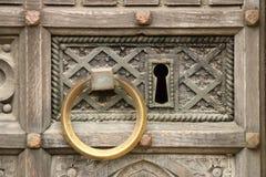 Antyczna drzwiowa rękojeść i kędziorek Zdjęcia Stock