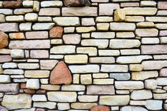 Antyczna kamienna ściana używać jako tło Zdjęcia Stock