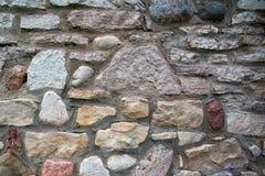 Antyczna kamienna stubarwna ściana Zdjęcia Royalty Free