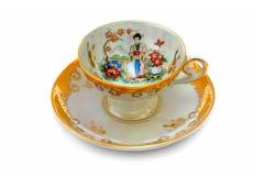 antycznej porcelanowej filiżanki gorąca herbata Zdjęcia Stock
