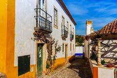Antyczni domy Portugalska wioska Obidos i ulicy fotografia stock