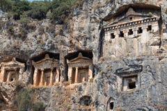 Antyczni Lycian skały grobowowie w Fethiye, Turcja fotografia stock