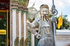 Antyczny Chiński wojownika demonu kamienia statuesat Wat Pho Obraz Stock
