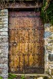 Antyczny drewniany drzwi, Catalonia Obrazy Royalty Free