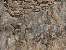 Antyczny kamienny kamieniarstwo na vertical skale Obrazy Stock