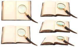 Antyk książka z powiększać - szkło Obrazy Royalty Free