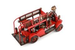 Antyka Zabawkarski Pożarniczy silnik na białym tle, odizolowywającym Zdjęcia Royalty Free