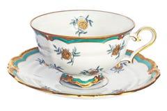 Antykwarska herbaciana filiżanka i spodeczek. obraz royalty free
