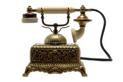 antykwarska mosiądza kołyska odizolowywający telefoniczny biel Zdjęcia Stock