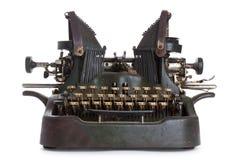 Antykwarski maszyna do pisania przeciw chrupiącemu białemu tłu Fotografia Royalty Free