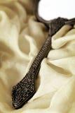 Antykwarski ręki lustro nad Miękką tkaniną Zdjęcia Royalty Free