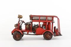 Antykwarski samochodu strażackiego model na białym tle Obraz Royalty Free