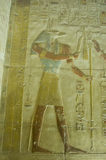 Anubis bas relief, Abydos Temple. Ancient Egyptian bas relief of the jackal headed god Anubis. Abydos Temple near el Balyana, Egypt stock photography