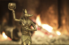 Anubis. Egyptian God Anubis on his knees offering in burning fire background royalty free stock photos