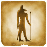 Anubis Egyptian symbol old paper. Anubis god of afterlife. Protector of tomb and dead holding Ankh and staff. Ancient Egypt element on weathered papyrus Stock Photos