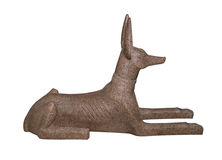 Anubis figurine. Egyptian souvenir, Anubis, God of Dead, made of pink granite, isolated on white background with clipping path. For more isolated objects please royalty free stock photography