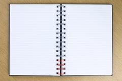 Anule o caderno aberto na tabela Fotos de Stock Royalty Free
