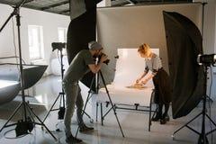 Anuncios publicitarios creativos del tiroteo del equipo Foto de archivo libre de regalías