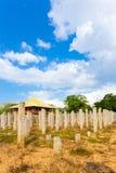 Anuradhapura Brazen Palace Stone Pillars Angled V. Upright original stone pillars are all that remain of the ruins of the Brazen Palace or Lovamahapaya on a Stock Image