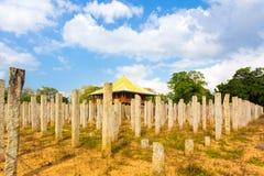 Anuradhapura Brazen Palace Stone Pillars Corner. Corner view of original stone pillars that remain at the ruins of the Brazen Palace or Lovamahapaya on a cloudy Stock Photography
