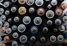 Använda batterier för återanvändning royaltyfria foton