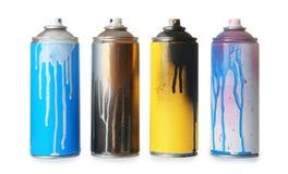 Använda cans av sprutmålningsfärg arkivfoton