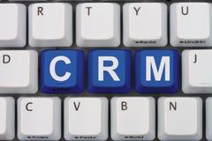 Använda CRM programvara royaltyfri foto