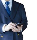 Använda den mobila telefonen Arkivfoton