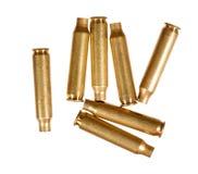 Använda gevärkassetter som isoleras på vit Royaltyfri Bild