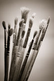 använda paintbrushes Royaltyfri Bild