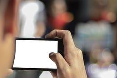 Använder händer för att ta bilder fotografering för bildbyråer