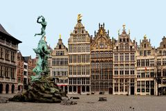 Anvers, Antwerp, Belgium. The statue of Brabo an the typical houses in Anvers. The mythical giant called Antigoon exacted a toll from those crossing the river Royalty Free Stock Photo