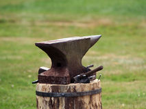 Anvil. Old blacksmith tools with green grass background Stock Images